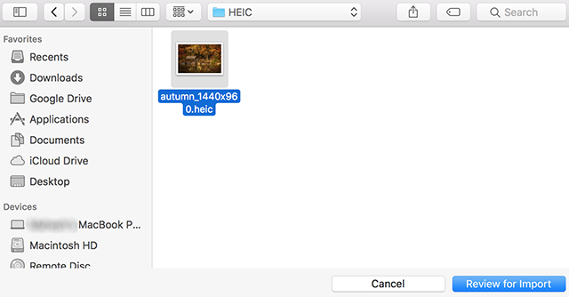 Browse for and select HEIC photos to be imported into the Photos app