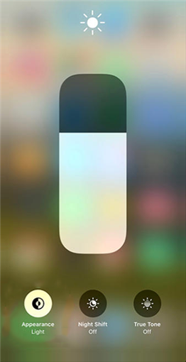 Enable the iOS 13 dark mode from the Control Center